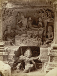 [Sculptured panel of Ravana under Kailasa, with Shiva and Parvati above, Hindu Cave XVI (Kailasanatha), Ellora.]